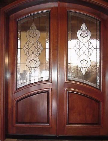 Gilliand arched beveled glass double entry doors for Exterior double doors with glass